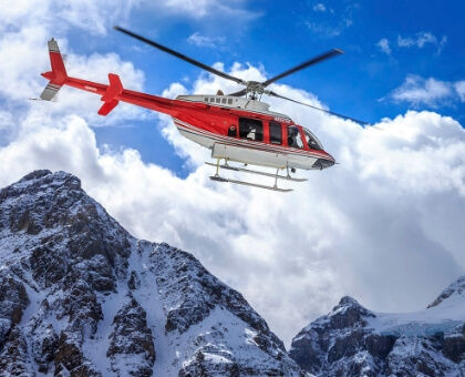 helicopter flying through mountains